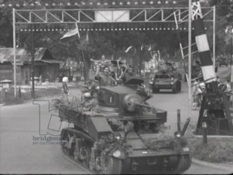 Decorated tanks parade in Batavia for Queens Day