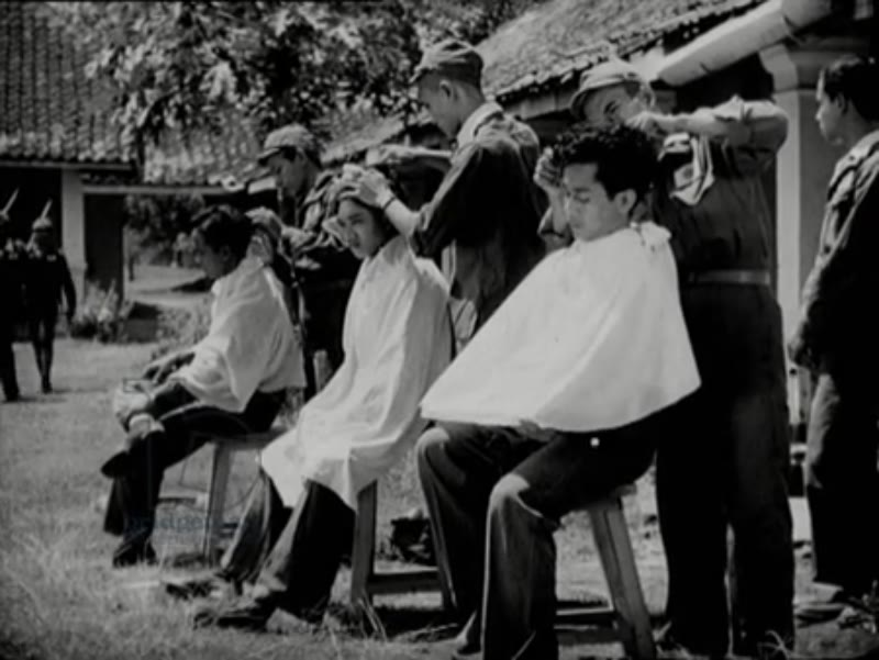 Measuring and weighing the Indonesian recruits, then their hair is shaved off