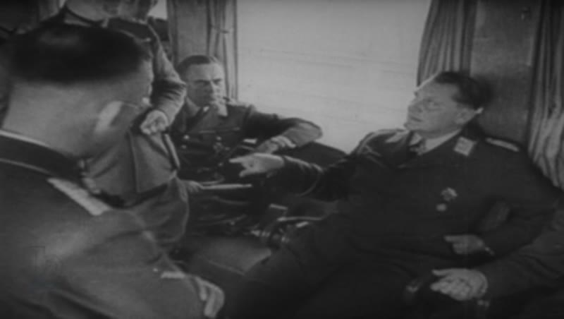 Hitler, Goering and other Nazi party leaders in discussion.