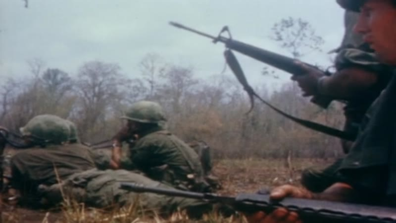 Vietnam war, Operation Junction City 1967. Wounded US soldiers. US troops fighting with M-16 rifles