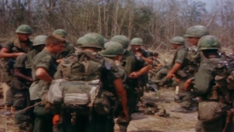 Vietnam war, Operation Junction City 1967. US soldiers studying aerial photo and waiting with ammo