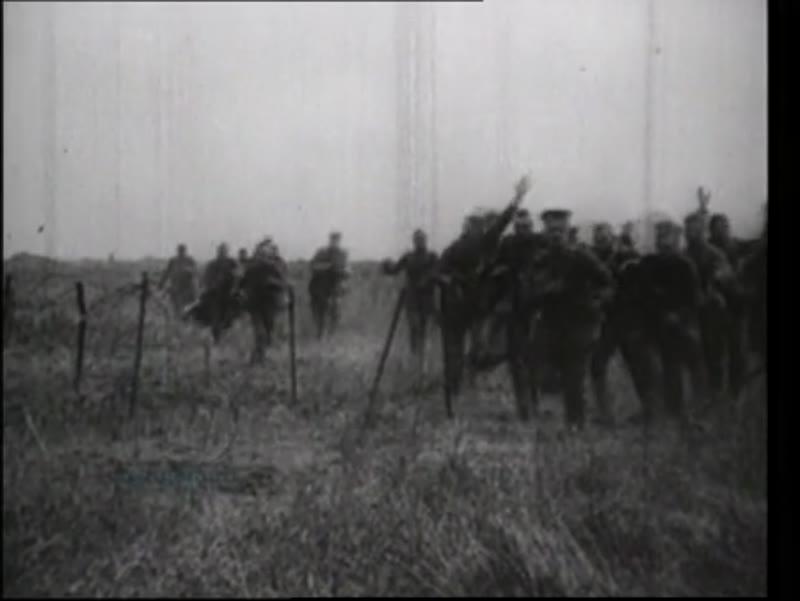 General Foche's car, tanks, German soldiers surrender on battlefield, German POWs are handed food. 1918