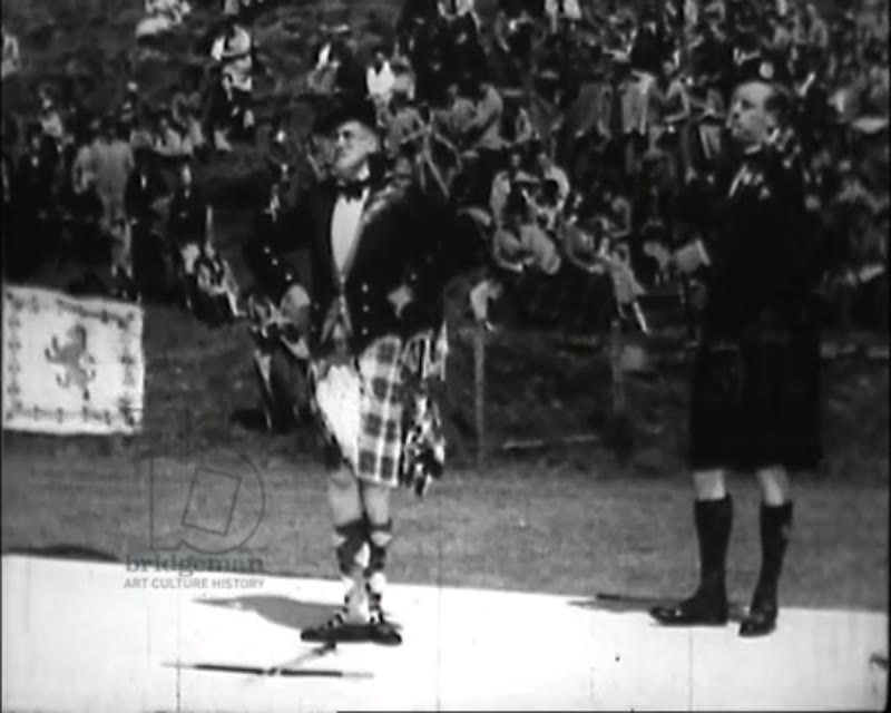 Traditional event in Mull, Scotland, 1930s - bagpipers and Highland dance contest